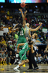 03 APR 2012: Devereaux Peters (14) of the University of Notre Dame and Brittney Griner (42) of Baylor University jump the opening tip off to start the game during the Division I Women's Basketball Championship held at the Pepsi Center in Denver, CO. Stephen Nowland/NCAA Photos