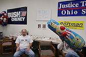 Cincinnati, Ohio.USA.October 25, 2004..In a Republican party Bush re-election office workers arrive with a blow up Kerry punching doll that they immediately begin to hit.