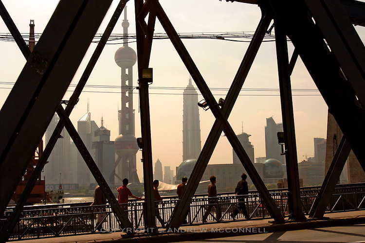 Residents are dwarfed by the Shanghai cityscape, Wednesday, May. 11, 2005. Shanghai is China's largest city with a population of 13million.