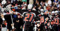 Tyler Moni (27) of Princeton celebrates the game-winning overtime goal during the Face-Off Classic in at M&T Stadium in Baltimore, MD