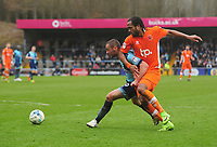 Blackpool's Nathan Delfouneso vies for possession with Wycombe Wanderers' Michael Harriman<br /> <br /> Photographer Kevin Barnes/CameraSport<br /> <br /> The EFL Sky Bet League Two - Wycombe Wanderers v Blackpool - Saturday 11th March 2017 - Adams Park - Wycombe<br /> <br /> World Copyright &copy; 2017 CameraSport. All rights reserved. 43 Linden Ave. Countesthorpe. Leicester. England. LE8 5PG - Tel: +44 (0) 116 277 4147 - admin@camerasport.com - www.camerasport.com