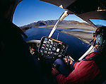 Fisheye lens view of interior of a Bell Jet Ranger Helicopter flying at low level over Lake Wanaka Otago New Zealand.
