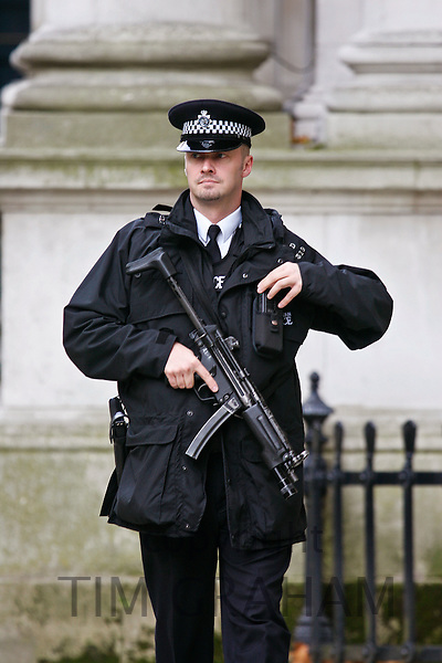 Armed policeman carrying an automatic weapon, London England, United Kingdom