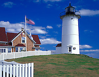 Cape Cod National Seashore, MA <br /> Nobska Point Light (1876) and light keeper's quarters bordered with a white picket fence, near Woods Hole on Nantucket Sound