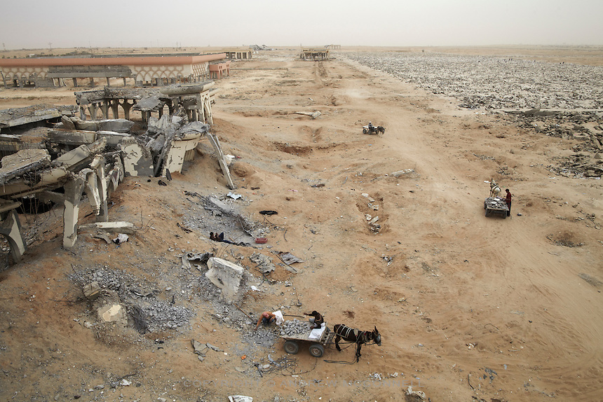 Stone collectors remove rubble from Yasser Arafat International Airport in southern Gaza. The airport was destroyed by Israeli warplanes in 2001 and 2002, and has become a source of building materials for much needed  reconstruction in Gaza.