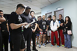 Fighters pre-fight briefing backstage. Irina Mazepa, 5X Wushu World Champion dressed in white<br />