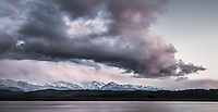 Cloud formation above Okarito Lagoon after winter sunset with Southern Alps in background, Westland Tai Poutini National Park, West Coast, South Westland, UNESCO World Heritage Area, New Zealand, NZ