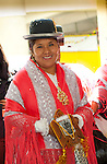 Bolivian cholita dressed in bowler hat and manta or shawl, the traditional indigenous Aymaran clothing, celebrating Bolivian Independence Day and the Virgin Mary, the patron saint of Bolivia, in La Paz, Bolivia.