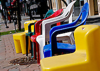 From the July 4, 2007 Children's Parade in Norwood MA. Chairs are placed on the sidewalks along the parade route hours before the parade begins to hold a spot.