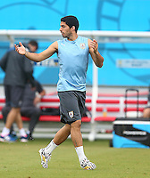 Luis Suarez of Uruguay gestures during training ahead of tomorrow's Group D fixture vs Italy
