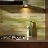"2"" x 8"" Bricks of Peridot Jewel glass are shown here in this custom kitchen backsplash."