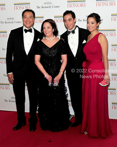 (Left to right) Yo-Yo Ma, Jill Hornor Ma, Nicholas and Emily Ma arrive for the formal Artist's Dinner honoring the recipients of the 2011 Kennedy Center Honors hosted by United States Secretary of State Hillary Rodham Clinton at the U.S. Department of State in Washington, D.C. on Saturday, December 3, 2011. The 2011 honorees are actress Meryl Streep, singer Neil Diamond, actress Barbara Cook, musician Yo-Yo Ma, and musician Sonny Rollins..Credit: Ron Sachs / CNP