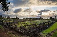 Pu'u o Mahuka Heiau overlooking the sunset on the North Shore of O'ahu.