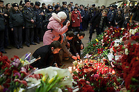 Moscow, Russia, 30/03/2010..People lay flowers and light candles at a makeshift shrine on the spot inside Lubyanka metro station where a female suicide bomber blew herself up the previous day. At least 39 people were killed and 80 injured in the double blasts at Moscow metro stations during the morning rush hour.