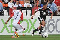 D.C. United Andy Najar (14) goes against Toronto FC forward Joao Plata (7) D.C. United defeated Toronto FC 3-1 at RFK Stadium, Saturday May 19, 2012.