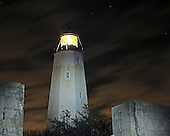 A view of Sandy Hook Lighthouse on a cloudy windy night.  This is the oldest working lighthouse in the United States guiding to mariners since 1764. Available as a limited edition fine art print.  Printed by a master printer to museum/conservation standard.