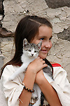 A Native American Indian girl holding a kitten