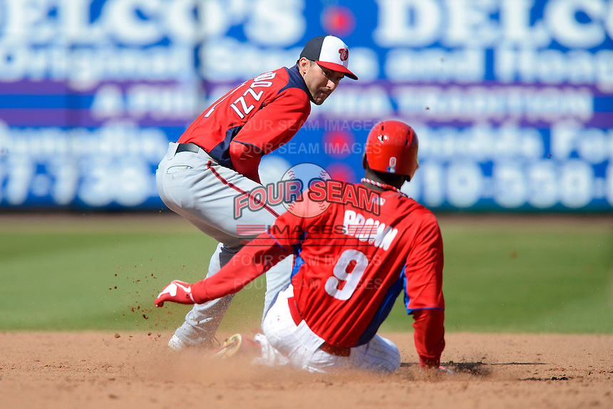 Washington Nationals infielder Steve Lombardozzi #1 takes a throw as Domonic Brown #9 slides in during a Spring Training game against the Philadelphia Phillies at Bright House Field on March 6, 2013 in Clearwater, Florida.  Philadelphia defeated Washington 6-3.  (Mike Janes/Four Seam Images)