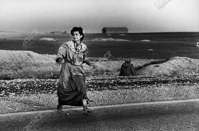 Kurdish woman seeking refuge from Iraqi helicopters strafing the area, Iraqi Kurdistan, 1991