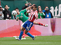 Javier Hernandez (left) and Paulo Da Silva (right) follow the ball. Mexico defeated Paraguay 3-1 at the Oakland Coliseum in Oakland, California on March 26th, 2011.