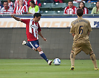 Chivas USA defender Ante Jazic (6) plants to kick the ball past Philadelphia Union midfielder Stefani Miglioranzi (6) during the first half of the game between Chivas USA and the Philadelphia Union at the Home Depot Center in Carson, CA, on July 3, 2010. Chivas USA 1, Philadelphia Union 1.
