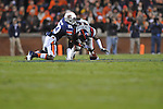 Ole Miss' Kentrell Lockett (40) recovers a fumble by Auburn running back Onterio McCalebb (23) at Jordan-Hare Stadium in Auburn, Ala. on Saturday, October 29, 2011. .