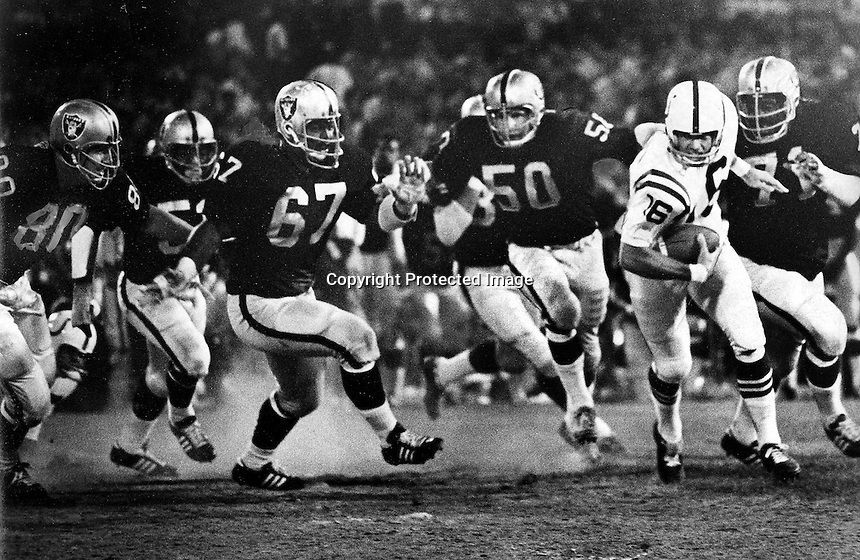 Colt runner is chased by 6 Raiders.photo Aug 8, 1970. Copyright Ron Riesterer