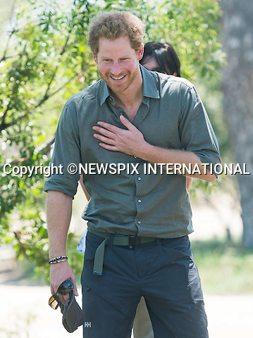 HELLO OUT<br /> 02.12.2015; Kruger, South Africa: PRINCE HARRY<br /> visited Kruger National Park to view the park ranger training schemes.<br /> Mandatory Photo Credit: &copy;DiasImages/NEWSPIX INTERNATIONAL<br /> <br /> PHOTO CREDIT MANDATORY!!: NEWSPIX INTERNATIONAL(Failure to credit will incur a surcharge of 100% of reproduction fees)<br /> <br /> IMMEDIATE CONFIRMATION OF USAGE REQUIRED:<br /> Newspix International, 31 Chinnery Hill, Bishop's Stortford, ENGLAND CM23 3PS<br /> Tel:+441279 324672  ; Fax: +441279656877<br /> Mobile:  0777568 1153<br /> *All Fees Payable to Newspix International*<br /> e-mail: info@newspixinternational.co.uk