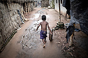 A child is seen playing inside the Posco India transit camp in Badagabapur, in Jagatsinghpur, Orissa. Posco Transit Camp is being set up for people who have been driven out of their villages for being pro-Posco, where they live on the side of a highway on $80 a day shared between 195 people.
