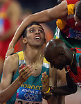 Hicham El Guerrouj gets a hug from the Silver Medal winner from Kenya Bernard Legat to win the Gold Medal in the 1500 Meters  at the 2004 Summer Olympic Games in Athens,Greece on Tuesday, August 24th, 2004.  Bronze Medal winner Rui Silva is at top right.           DENVER POST PHOTO BY STEVE DYKES