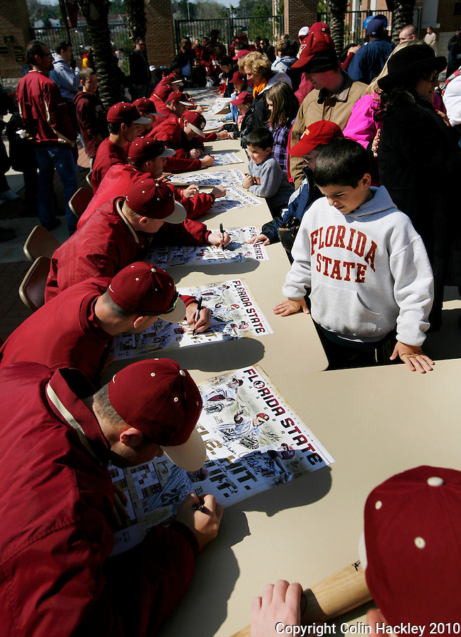 TALLAHASSEE, FL 2/13/10-FSU-BSB FANDAY10 CH10-Florida State baseball players autograph during Fan Day Saturday in Tallahassee...COLIN HACKLEY PHOTO