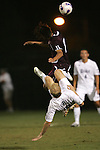 05 October 2007: Duke's Mike Grella (9) goes for an overhead clearance, but ends up fouling Boston College's Karl Reddick (17). Boston College defeated Duke University at Koskinen Stadium in Durham, North Carolina in an NCAA Men's soccer game.