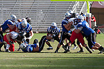 Friendswood running back Jonathan Johnson (5) hits the hole opened by the Mustang offensive line.  The  Mustangs lost to the Lake Travis Cavilers 24 - 3 at Kyle Field on December 11, 2010 in the Class 4A, D-1 state semifinals.