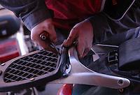 """Officina meccanica a conduzione familiare """"Carpenti Vincenzo""""..Tutta la famiglia Carpenti, moglie, marito e due figli, lavora nell'officina meccanica, dove si riparano moto e motorini..Mechanical workshop of family Carpenti..All family Carpenti, wife, husband and two children, work in mechanical workshop, where they repair motorcycles and scooters.."""