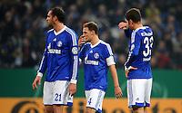 FUSSBALL   DFB POKAL    SAISON 2012/2013    ACHTELFINALE FC Schalke 04 - FSV Mainz 05                          18.12.2012 Christoph Metzelder, Benedikt Hoewedes und Roman Neustaedter (v.l, alle FC Schalke 04) sind enttaeuscht