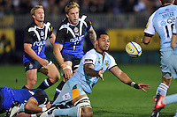 Samu Manoa offloads the ball after being tackled. Aviva Premiership match, between Bath Rugby and Northampton Saints on September 14, 2012 at the Recreation Ground in Bath, England. Photo by: Patrick Khachfe / Onside Images