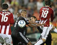 Jordan Graye #16 of D.C. United gets between Sacha Kljestan #16 and Blair Gavin #18 of Chivas USA during an MLS match at RFK Stadium, on May 29 2010 in Washington DC. United won 3-2.