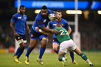 Mathieu Bastareaud of France looks to get past Ian Madigan of Ireland. Rugby World Cup Pool D match between France and Ireland on October 11, 2015 at the Millennium Stadium in Cardiff, Wales. Photo by: Patrick Khachfe / Onside Images