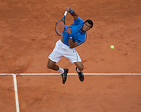 Jo-Wilfried Tsonga (FRA) (9) against Julien Benneteau (FRA) in the first round of the Men's Singles. Tsonga beat Benneteau 6-4 3-6 6-3 6-4..Tennis - French Open - Day 3 - Tues 26th May 2009 - Roland Garros - Paris - France..Frey Images, Barry House, 20-22 Worple Road, London, SW19 4DH.Tel - +44 20 8947 0100.Cell - +44 7843 383 012