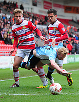 Blackpool's Mark Cullen is tackled by Doncaster Rovers' Will Longbottom, left, and Doncaster Rovers' Mathieu Baudry<br /> <br /> Photographer Chris Vaughan/CameraSport<br /> <br /> The EFL Sky Bet League Two - Doncaster Rovers v Blackpool - Keepmoat Stadium - Doncaster<br /> <br /> World Copyright &copy; 2017 CameraSport. All rights reserved. 43 Linden Ave. Countesthorpe. Leicester. England. LE8 5PG - Tel: +44 (0) 116 277 4147 - admin@camerasport.com - www.camerasport.com