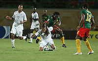 The United States' Tony Taylor (7) is balled over by Cameroon's Jean Bapidi (18) during the FIFA Under 20 World Cup Group C Match between the United States and Cameroon at the Mubarak Stadium on September 29, 2009 in Suez, Egypt.