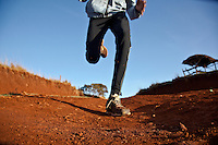 3,000-metre steeplechase newcomer Johanna Kariankei, 17, trains close to the Kenyan town of Iten. Athletes there are being hit by the economic crisis which is robbing races and runners of crucial sponsorship for overseas competitions. Johanna, who has never run outside Kenya, hopes the crisis will pass and he will be able to fulfil his dream of winning good money from international races.