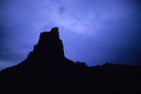 A lone butte stands quiet in the eerie calm of dawn, Canyonlands National Park, Utah.