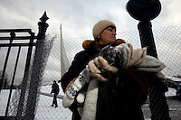A woman sells hand-made socks in central Moscow in front of a Soviet space momument. .Picture by Justin Jin.