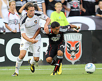 Andy Najar #14 of D.C. United is held by Todd Dunivant #2 of the Los Angeles Galaxy during an MLS match at RFK Stadium on July 18 2010, in Washington D.C. Galaxy won 2-1.
