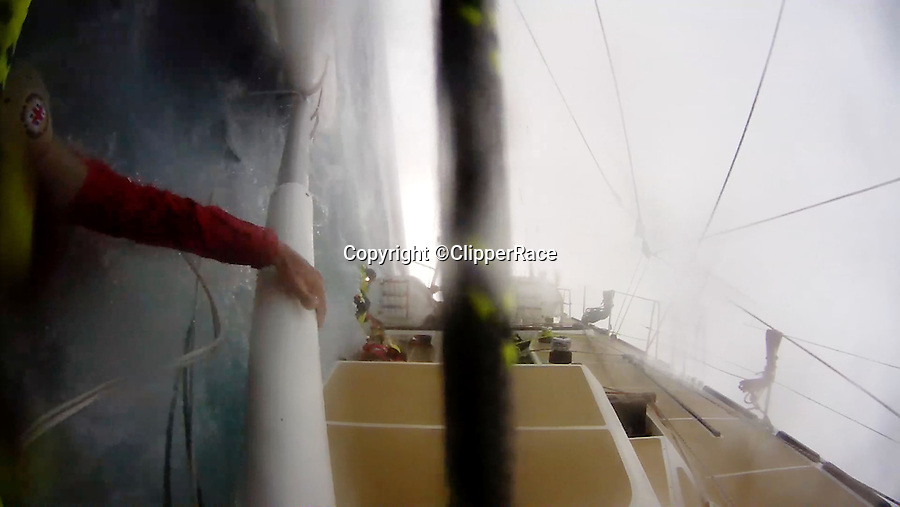 BNPS.co.uk (01202 558833)<br /> Pic: ClipperRace/BNPS <br /> <br /> ***Please Use Full Byline***<br /> <br /> Paul Hardy (43) regains grip of the mast. Liz Richards (65) and Sarah Usher (34) are still in the water. <br /> <br /> This is the heart-stopping moment two British sailors are washed off the side of a yacht as it is knocked flat by a tornado in the middle of the ocean.<br /> Sarah Usher and Liz Richards are seen desperately trying to grab hold of the 70ft boat as they are swept overboard when the freak weather conditions hit.<br /> Their 70ft yacht was blown onto one side as the wind built then smashed almost 180 degrees onto the other as the tornado struck.<br /> Winds of more than 115mph pinned the capsized yacht down for around 60 seconds.<br /> Dramatic footage of the ordeal shows the boat's crew dragging the pair out of the water and back on board the boat as the winds ease.<br /> The tornado can then be seen disappearing into the distance as the boat returns to upright.<br /> Sarah, 34, from Hull, East Yorks, and Liz, 65, from Dartmouth, Devon, were both wearing life jackets at the time and were shaken but uninjured in the ordeal.<br /> They were part of an 18-strong crew on the Great Britain yacht competing in the Clipper Round the World Race, a 40,000-mile yacht race for amateur sailors.