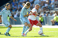 Red Bull midfielder Joel Lindpere (20)  hold off the challenge from Sporting KC defender Chance Myers...Sporting Kansas City defeated New York Red Bulls 2-0 at LIVESTRONG Sporting Park, Kansas City, Kansas.