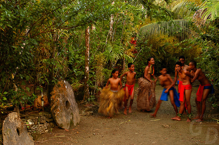 """The small Island of Yap know for its Stone Money located in the South Pacific and is part of Micronesia. Time has stood still in this part of the world and the Yapese treasure even today their culture and tradition. Women walking around topless without a shame and go about their daily life. But Yap is also famous for its """"resident"""" large Manta Rays and many other amazing ddive sites. Yap, Micronesia"""