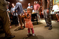 LITTLE ST. SIMONS ISLAND, FL -- October 1, 2010 -- Willa Rollins, 3, plays with a stuffed armadillo during a cocktail hour on Little St. Simons Island on Friday, October 1, 2010.   The 10,000 acres of marshland, beaches, and forests are a refuge for wildlife and vacationers alike with only 32 guests permitted a night.  (Chip Litherland for Bay Magazine)