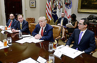 United States President Donald Trump discusses the Federal budget in the Roosevelt Room of the White House on February 22, 2017 in Washington, DC. OMB director Mick Mulvaney sits to the President's right and Treasury Secretary Steven Mnuchin sits to his left.<br /> Credit: Olivier Douliery / Pool via CNP /MediaPunch